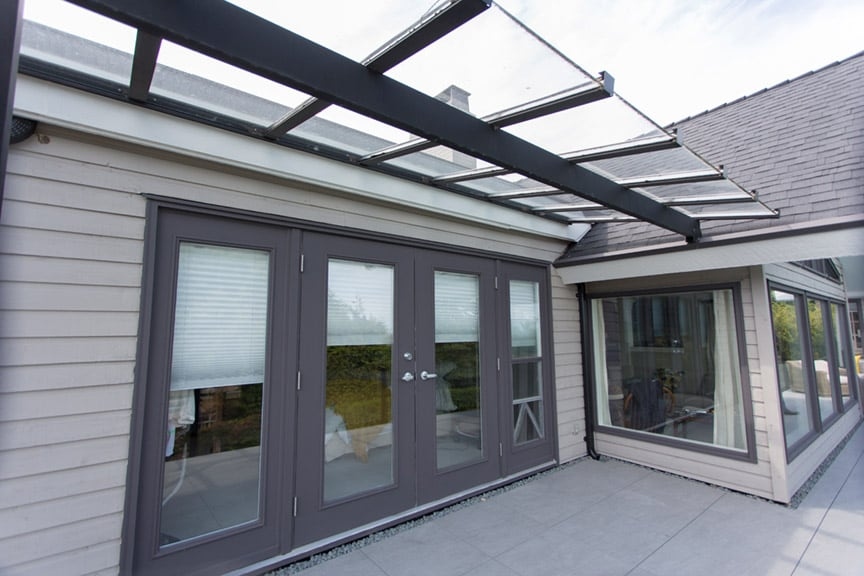 glass patio cover installation | Citywide Sundecks and Railings