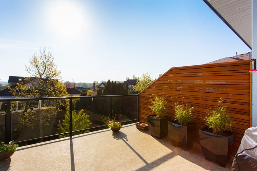 custom wooden privacy wall | Citywide Sundecks and Railings