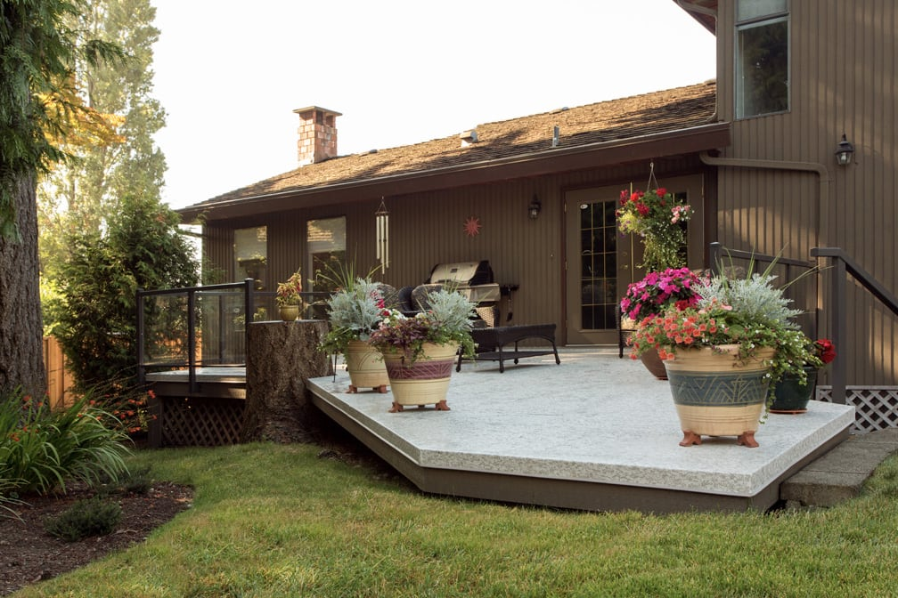 vinyl patio built around tree stump | Citywide Sundecks and Railings