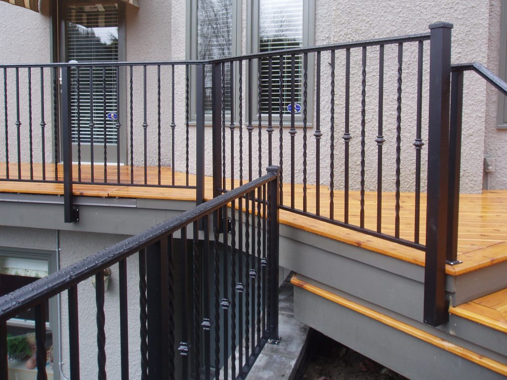 Spanish top, twist, collared custom ornate aluminum picket railings side mount | Citywide Sundecks