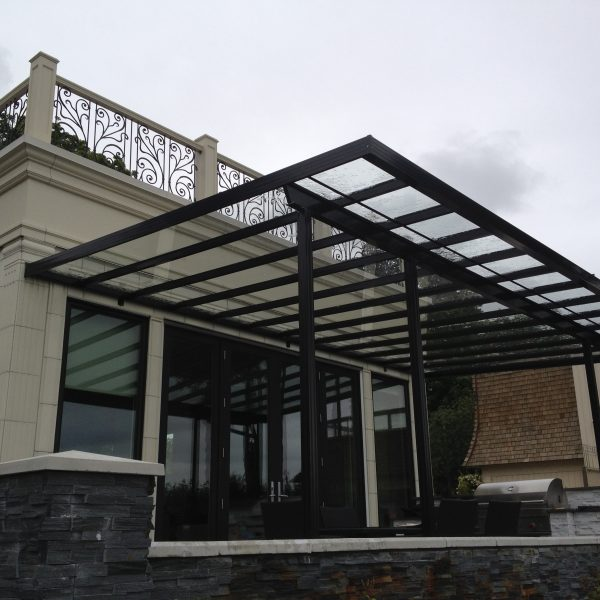 Custom black aluminum and glass patio cover | Citywide Sundecks and Railings